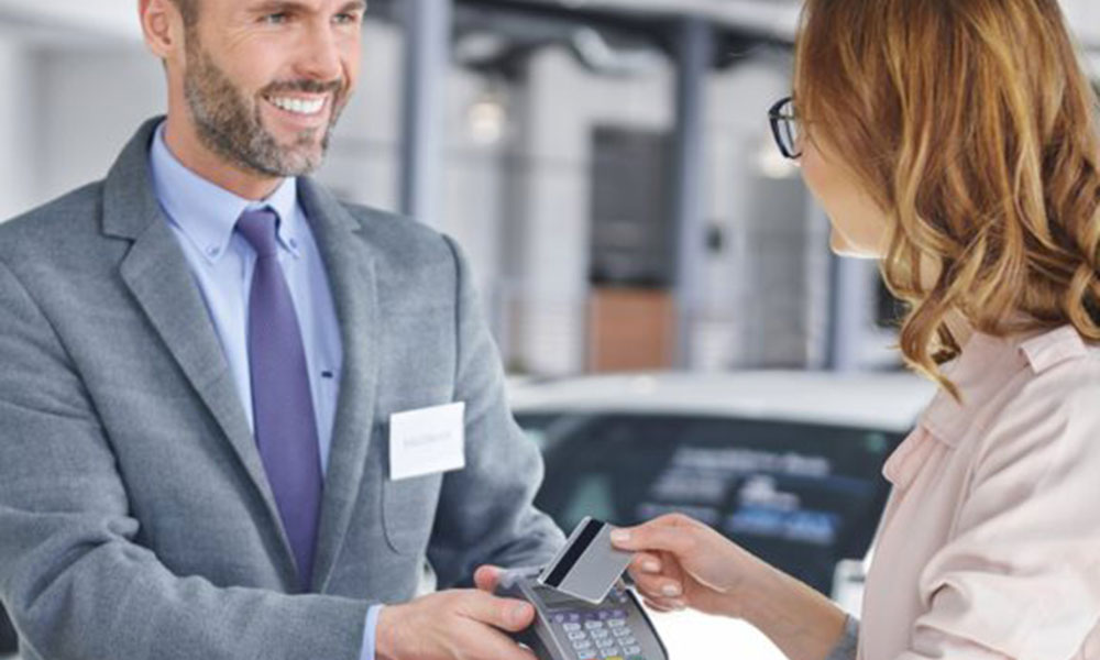 Auto Dealer swiping credit card